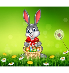 Happy easter bunny with easter egg in the basket vector