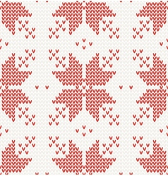 Seamless knitted pattern with red stars vector