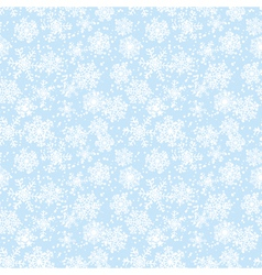 Blue seamless background with snowflakes vector