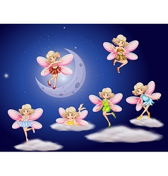 Fairies flying in the sky at night vector
