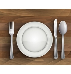 Plate spoon knife and fork on wood vector
