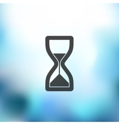Hourglass icon on blurred background vector