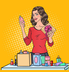 Pop art woman wrapping cosmetics in gift box vector