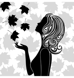 Silhouette of young woman with flying leaves vector