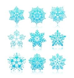 Hand-drawn snowflakes silhouettes isolated vector