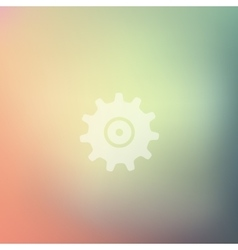 Cogwheel icon on blurred background vector