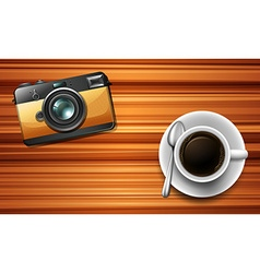Camera and a coffee on table vector image vector image
