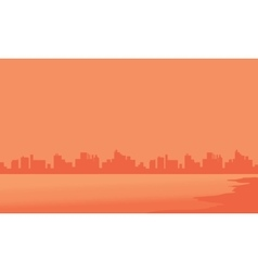 Silhouette of building and beach vector
