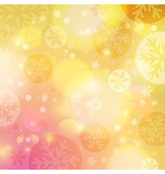 Bright yellow background with bokeh and snowflakes vector