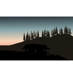Silhouette of hut with spruce backgrounds vector