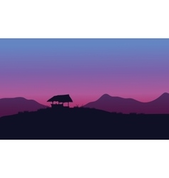 Silhouette of hut with purple backgrounds vector