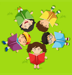 Kids reading book on green grass vector