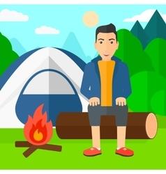 Man sitting at camp vector