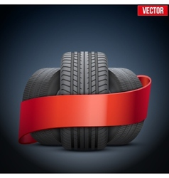 Realistic wheels and tire concept with ribbon vector image