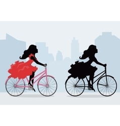 Silhouettes of women on the bike vector