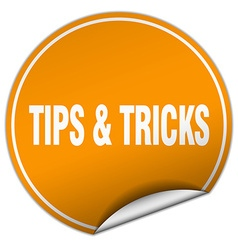 Tips tricks round orange sticker isolated on vector