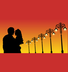 Lovers and vintage lampposts at sunset vector