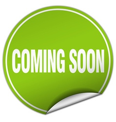 Coming soon round green sticker isolated on white vector