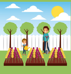 Mother and son watering flowers in plowing field vector