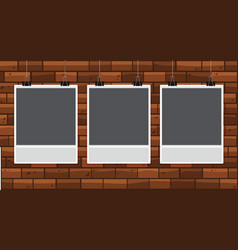 Three pictureframes on brickwall vector