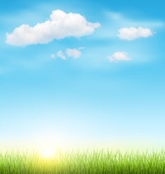 Green grass lawn with clouds and sun on blue sky vector