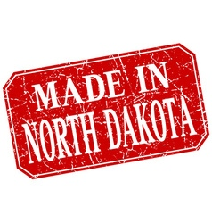 Made in north dakota red square grunge stamp vector