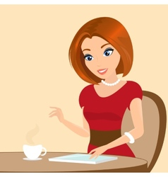 Young pretty woman sitting in the cafe and using a vector