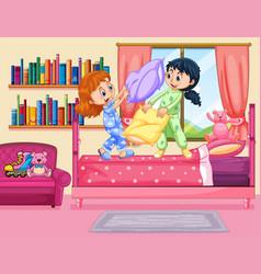 two girls pillow fighting in bedroom vector image