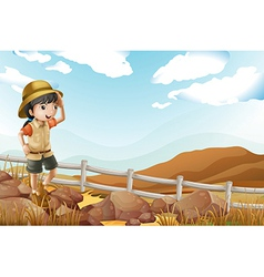 A young female explorer walking alone vector image