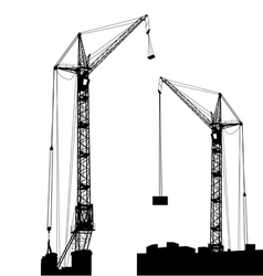Silhouette of two cranes working on the building vector