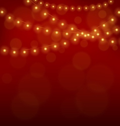 Golden christmas lights on red vector