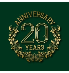 Golden emblem of twentieth years anniversary vector image