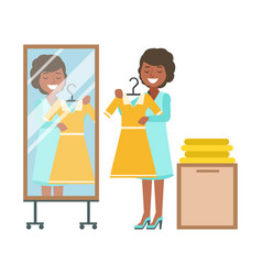 Woman trying on yellow dress in dressing room vector