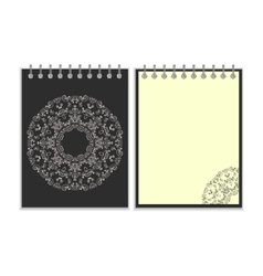 Black cover notebook with round ornate pattern vector image