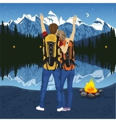 young couple of hikers with hands up vector image