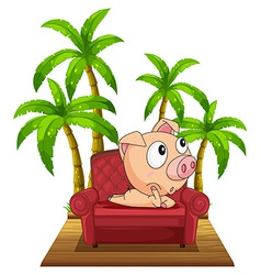 A pig sitting at the chair near the coconut trees vector
