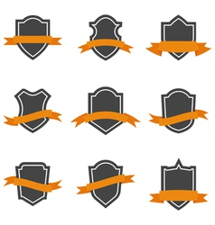 Set of shield icons with ribbons vector