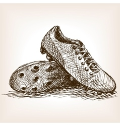 Football boots hand drawn sketch style vector