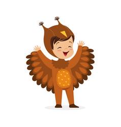Cute happy little boy dressed as an owl kids vector