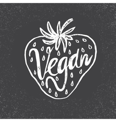 Hand drawn strawberry with text vegan on grunge vector