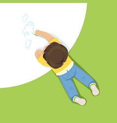 Little boy lying on his stomach and drawing clouds vector