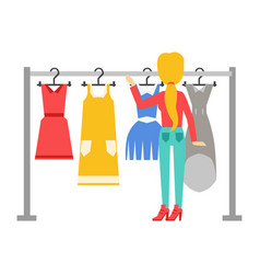 Woman choosing dresses during shopping or being in vector