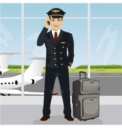 Young pilot talking on phone with luggage vector image