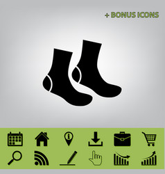 Socks sign black icon at gray background vector