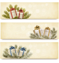 Three christmas banners with gift boxes and vector image vector image
