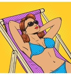 Woman sunbathing on the beach pop art vector