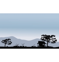 Silhouette of hut with trees vector