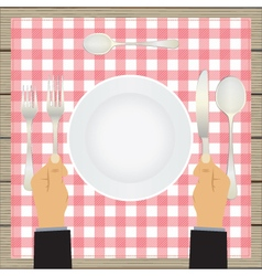 Hand with a knife and fork tableware vector