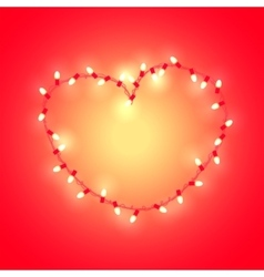 Stylized heart made of glowing garland vector image vector image