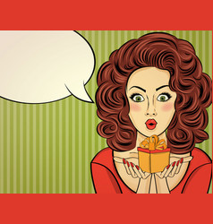 Surprised pop art woman that holds a gift in vector
